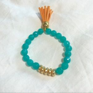 Jewelry - Aqua beaded bracelet with leather tassel